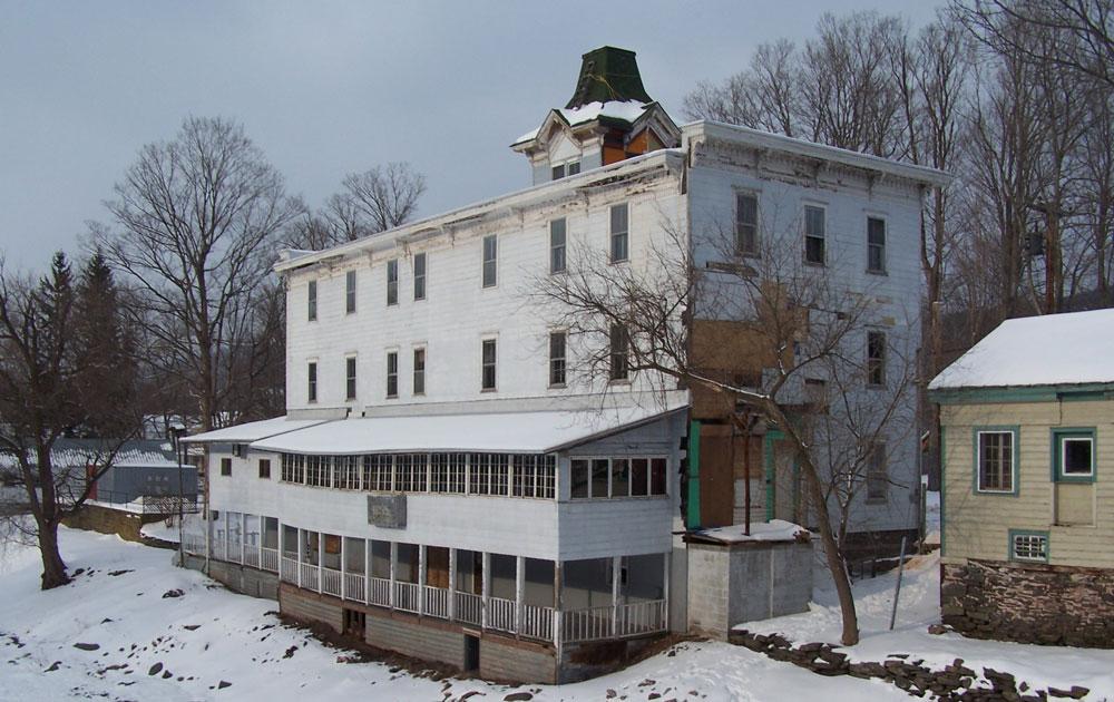 Sardo Land Surveying - large white building