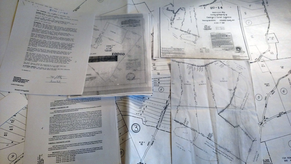 Several items of paperwork such as maps and deeds